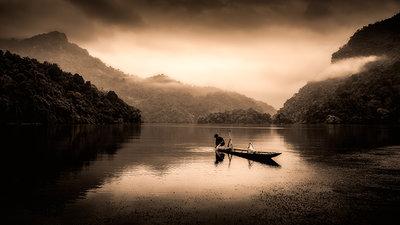 Ba be lake Vietnam fisherman